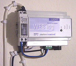 Detail of installed WEB'log light in place, prior to connecting the power supply. Cables in left lower corner from left to right: solar power OUT (to Voltcraft digital meter), telephone line and directly adjacent (black) power of WEB'log light, solar power IN.