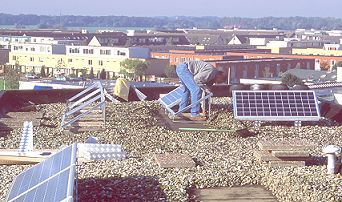rush hour on the flat roof on October 12 2001: installation of two new 648 Wp PV-systems