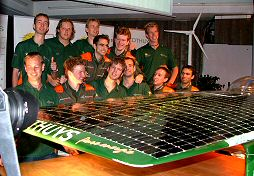 "Proud Twente University's student Solar Team in front of ""their"" Solutra racing car, high-end candidate for a victory in Australia's World Solar Challenge race, september 2005."