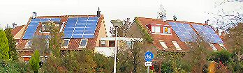 "Four houses filled with PV-panels in Spijkenisse, the Netherlands. A.k.a. ""De Blauwe Hoek"" (""the Blue Corner""...). Ton Peter's house is second from right."
