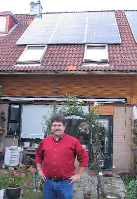 "Ton Peters proudly showing ""his"" 2700 Wp PV-installation which is monitored continuously."